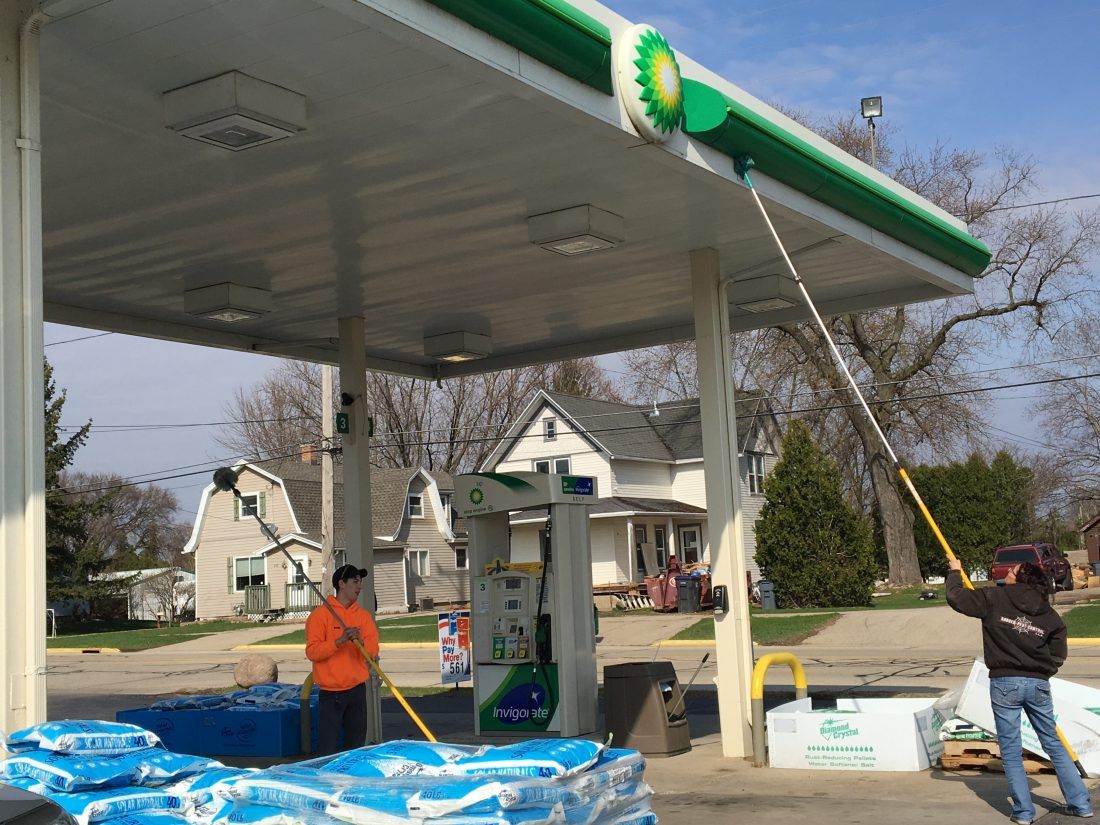 These are crew members clearing a BP gas station of insects.